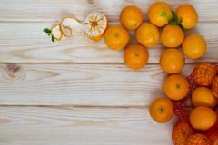 Tangerines scattered on a wooden board and there is a place for an inscription Royalty Free Stock Photo
