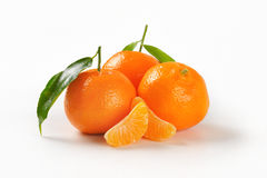 Tangerines with separated segments Stock Photos