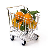 Tangerines in shopping cart. Isolated tangerines in shopping cart Stock Photo