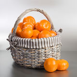 Tangerines on Silver Stock Images