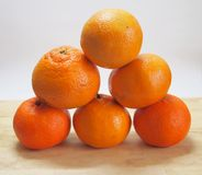 Tangerines. Some tangerines on a desk Royalty Free Stock Image