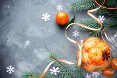 Tangerines in spicy sugar syrup, sweet Christmas treats, winter Stock Images