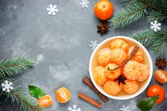 Tangerines in spicy sugar syrup, sweet Christmas treats, winter. Seasonal background top view royalty free stock photos