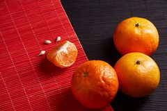 Tangerines mandarins, clementines, citrus fruits on style black and red background with copy space. Tangerines on style black and red background with copy space Stock Photography
