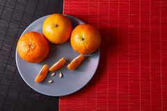 Tangerines mandarins, clementines, citrus fruits on style black and red background with copy space. Tangerines on style black and red background with copy space Stock Image