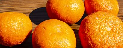 Tangerines in the sun on a brown background stock photos