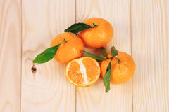 Tangerines on the table. Of wood Royalty Free Stock Image