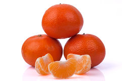 Tangerines and tangerines slices on white background Royalty Free Stock Images