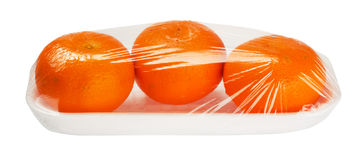 Tangerines in vacuum packing Stock Images