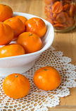 Tangerines in a vase. Still life Stock Photo