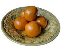 Several tangerines are in a deep dish royalty free stock photos