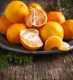 Tangerines on vintage plate Stock Photos