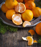 Tangerines on vintage plate Royalty Free Stock Images