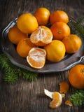 Tangerines on vintage plate. Stock Photos