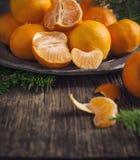 Tangerines on vintage plate. Stock Image