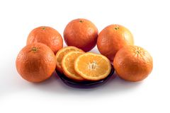 A lot of tangerines on a white background royalty free stock photos