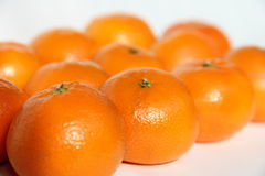 Tangerines on white. Tasty tangerines on white background Royalty Free Stock Image