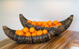 Tangerines in wicker basket Stock Images