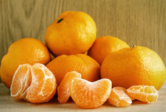 Tangerines on wood Stock Photography