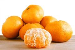 Tangerines on wood Stock Photos