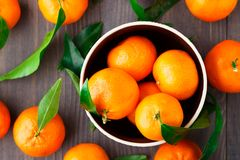 Tangerines on wooden background Royalty Free Stock Photos