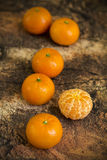 Tangerines on wooden background Royalty Free Stock Image