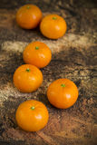 Tangerines on wooden background Stock Image