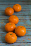 Tangerines on wooden background Royalty Free Stock Photography