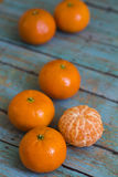Tangerines on wooden background Royalty Free Stock Images