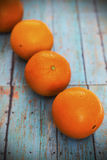 Tangerines on wooden background Stock Images