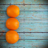 Tangerines on wooden background Stock Photos