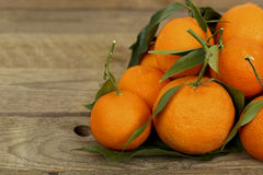 Tangerines. On wooden surface closeup Royalty Free Stock Photos
