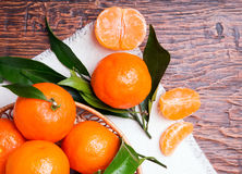 Tangerines on wooden table Stock Image