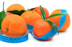 Tangerines wrapped around a tape royalty free stock photo
