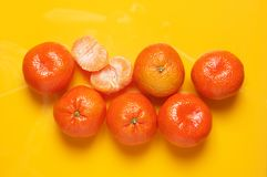 Tangerines on yellow background royalty free stock photography
