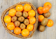 Tangerins and kiwis Stock Photography