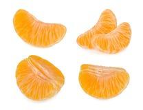 Tangerinskivor som isoleras på vit bakgrund arkivfoton