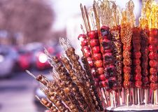 Tanghulu, Chinese candied fruit on the stick, Chinese food. Very popular in nothern regions stock photography