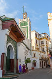 Tangier, Morocco. Arabic women stand near old mosque Stock Photography