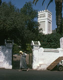 TANGIER, MOROCCO - AUGUST, 1979. A man with turban and djellaba spent in front of a English Church on August, 1979 in Tangier, Morocco Stock Photo