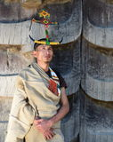Naga tribeman of Northeast India. A Tangkhul Naga tribeman of Notheast India in Manipur with his traditional head gear and indigenous shawl. The backdrop wall is Royalty Free Stock Photo