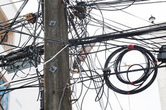 Tangle of cables and wires. And white sky Royalty Free Stock Photo
