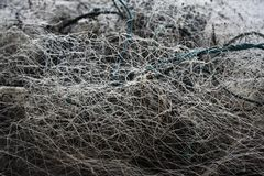 Tangle of fishing net. Textures and Backgrounds: Disorganized tangle of a fishing net standing in the harbor royalty free stock image