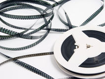 Tangle of old film strip. With one reel on white background Stock Image