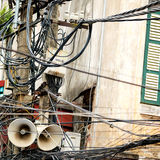 Tangle of Power Lines and Speakers, Hanoi, Vietnam Stock Images