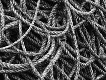 A tangle of rope background. Large amount of uncoiled tangle of rope background Royalty Free Stock Photography