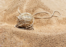 Tangle of rope lying on the sand Stock Image