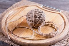 Tangle of thread on a wooden board. On the table Royalty Free Stock Images
