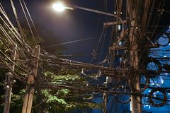 Tangle of wires in the capital city in the Night. Stock Image