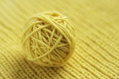Tangle of yellow wool yarn for knitting. Tangle of yellow wool ball Royalty Free Stock Image